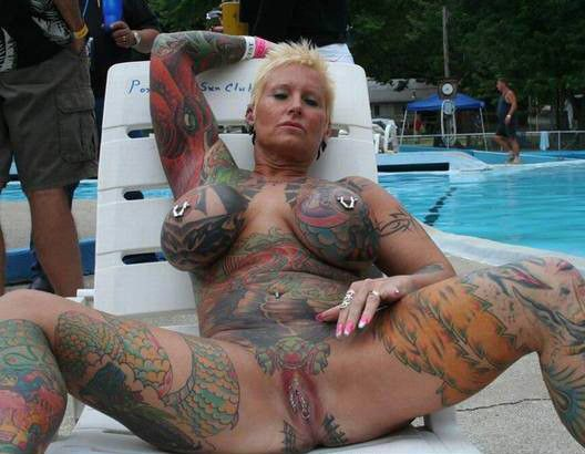 nude women big tattooed breasts