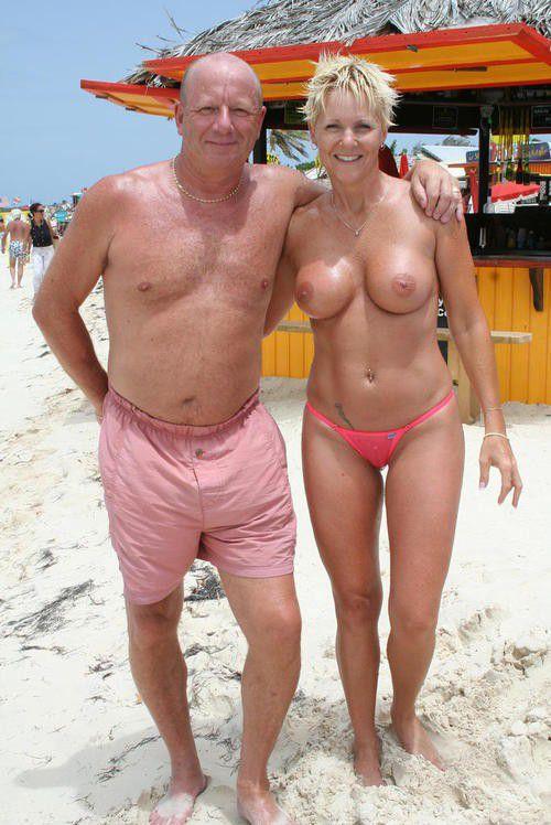 Busty mom on the beach - Mom Porn Photo