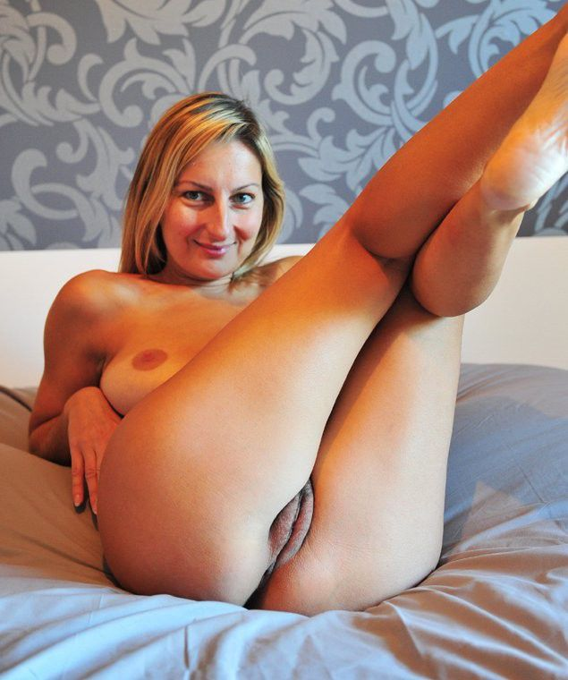 sexy woman showing her nice legs and puffy pussy lips